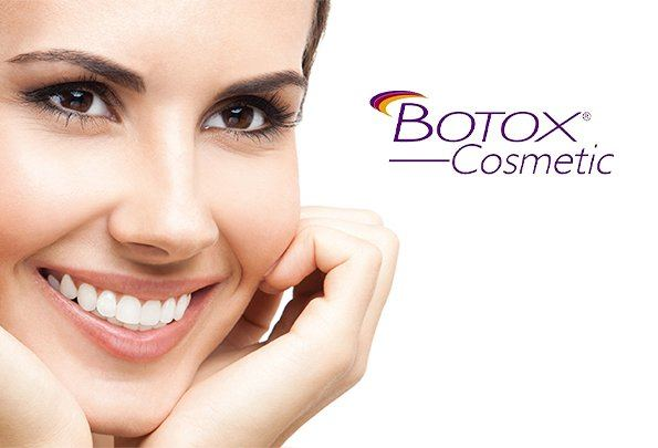 Smiling woman next to Botox logo